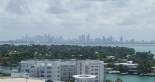 south florida real estate icon miami sklyline distant
