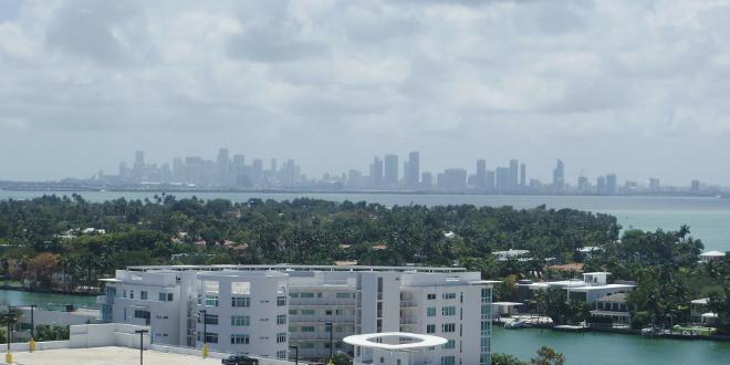south florida real estate icon miami sklyline distant