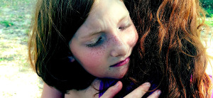 helping kids cope with loss icon girl hugging