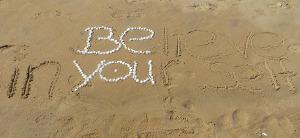bruce turkel icon be you slogan on beach