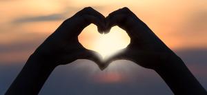 vivian fried icon heart hands framing sunrise