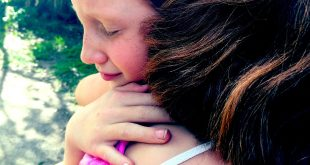 helping children cope with loss icon child hug