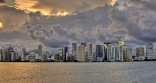 akerman icon miami skyline cloudy